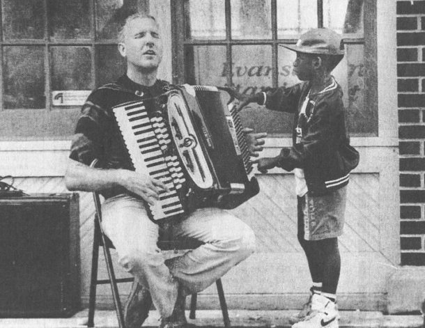 John Devlin plays accordian
