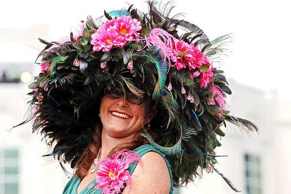 Lady wearing crazy Derby Day hat made with feathers and flowers