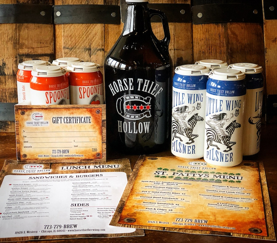 tabletop display showing a Horse Thief Hollow growler, lunch menu, two four pack cans of beer, and a St. Paddy's menu